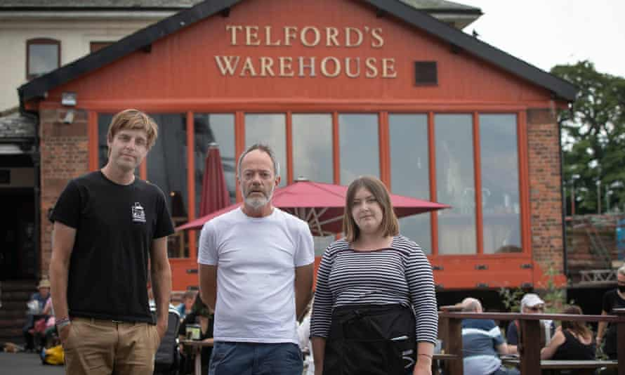 Jeremy Horrill with two members of his staff at Telford's Warehouse bar and restaurant in Chester