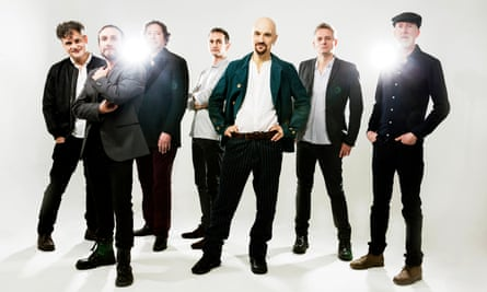'Peak big James': the enduring Manchester band, with singer Tim Booth third from right.