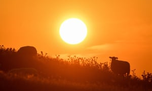 The sun rising over Burton Dassett hills in Southam, Warwickshire in July 2019, the hottest on record.