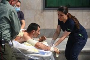 Armenian medics help a man, who said was injured in clashes in Azerbaijan's breakaway region of Nagorno Karabakh.