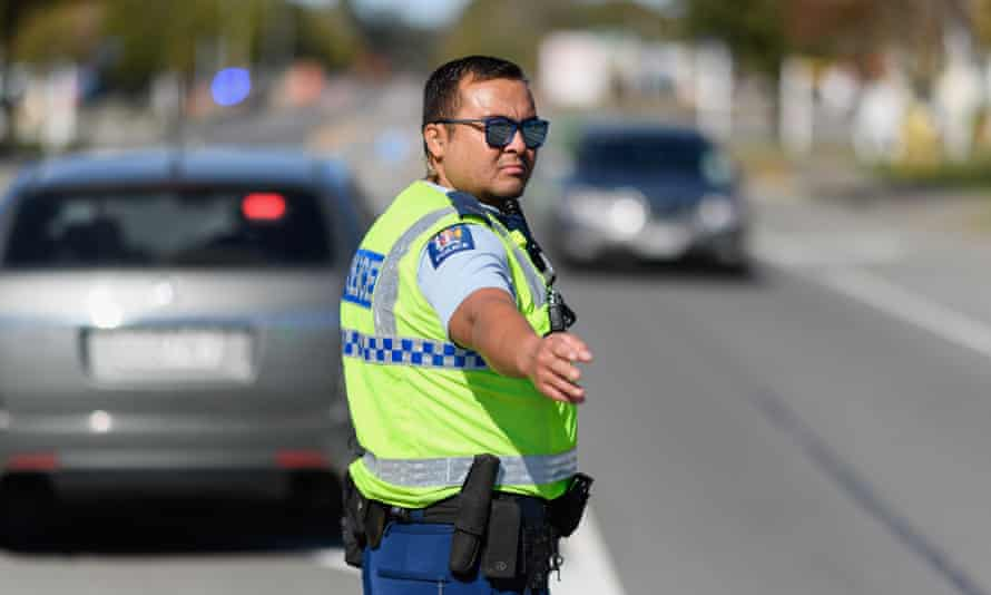 Easter Weekend Checkpoints In Place As New Zealanders Are Told To Stay Home For Easter During Coronavirus LockdownAMBERLEY, NEW ZEALAND - APRIL 10: A police officer stops cars travelling north towards Hanmer Springs at a checkpoint on April 10, 2020 in Amberley, New Zealand. With New Zealand in lockdown due to COVID-19, police are setting up checkpoints across the country to ensure people on the roads are travelling for essential purposes only. The Easter long weekend is a popular time for New Zealanders to go on holiday, however current Level 4 restrictions in place due to the coronavirus (COVID-19) pandemic requires everyone to remain at the place of residence they were in as of midnight 25 March when New Zealand went into lockdown. (Photo by Kai Schwoerer/Getty Images)
