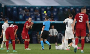 Turkey's defender Caglar Soyuncu is shown a yellow card.
