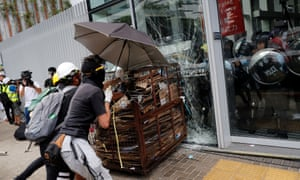 Protesters try to break into the Legislative Council building where riot police are seen, during the anniversary of Hong Kong's handover to China in Hong Kong.