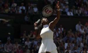 Serena Williams serves.