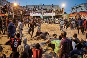 Sports, second prize, stories - Christian Bobst - The gris-gris wrestlers of Senegal: a tournament in the Adrien Senghor arena. The wrestling takes place in the late evenings when temperatures drop