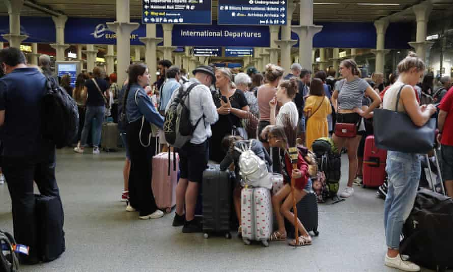 People wait to board the Eurostar at St Pancras International train station in London