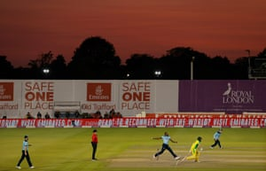 Joffra Archer bowling under a red sky.