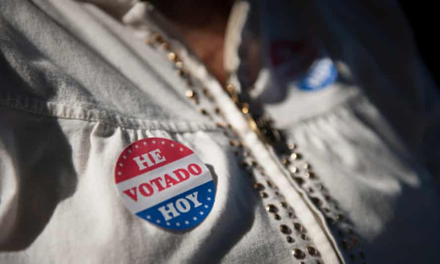 A voter wears her voting sticker outside a polling location for the 2016 US presidential election