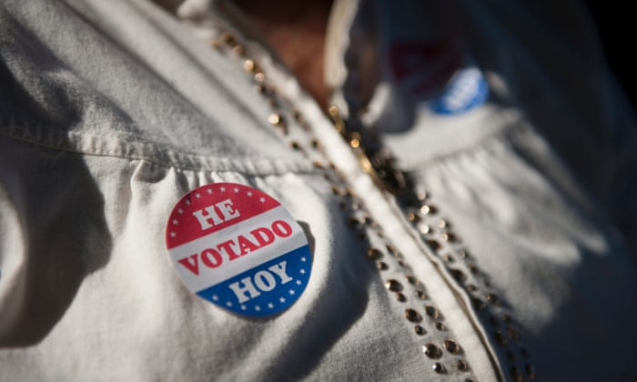 A voter wears her voting sticker outside a polling location for the 2016 US presidential election.