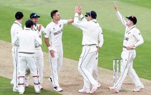Trent Boult of New Zealand celebrates taking the wicket of Cheteshwar Pujara of India.