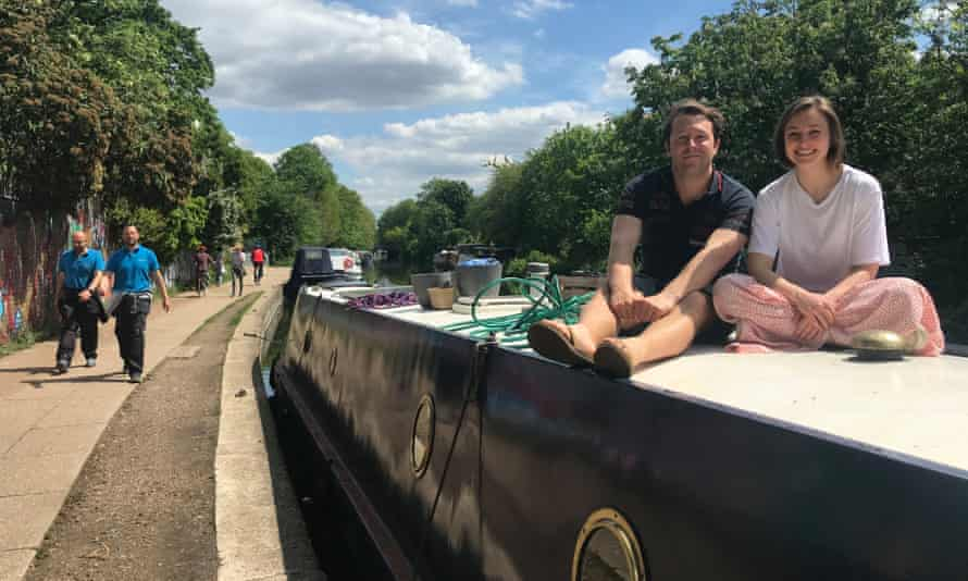 Annie Mellor and Hayden Crocker on their narrowboat on Regent's Canal in London.
