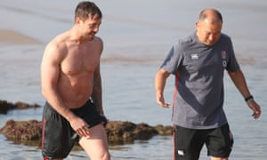 Danny Cipriani chats with England coach Eddie Jones during a recovery session on Umhlanga beach near their Durban base for the South Africa tour in June.