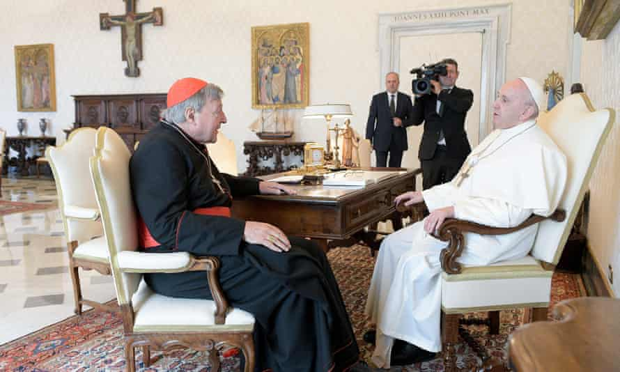 Pope Francis speaks with Cardinal George Pell in Vatican City on 12 October