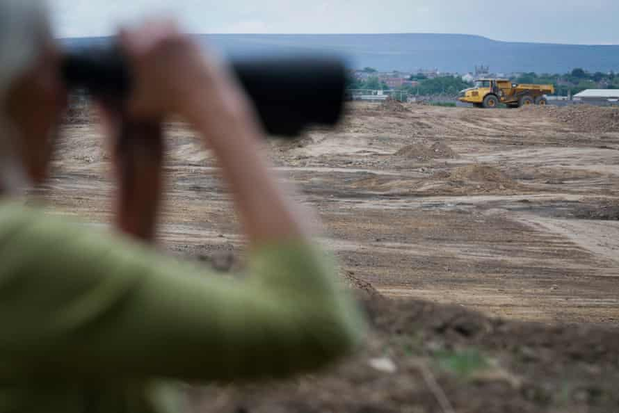 Protesters observe mining activity on the Bradley open-cast coal mining site