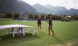 Brazil defender Monica and forward Kerolin playing Teqball, a hybrid of football and table tennis, taken by defender Tamires