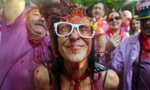 Make it a large red: a man pours wine on a girl's head during the Battle of Wine in Haro in the northern Spanish province of La Rioja to celebrate St Peter's Day.
