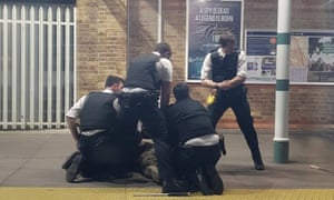 Police arrest the man at Tulse Hill station, south London.