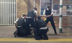 Social media showing police detaining the man at Tulse Hill station