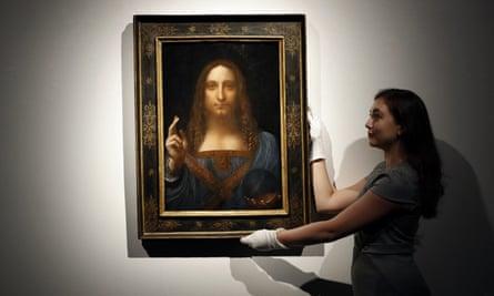 Art gallery employee with Salvator Mundi