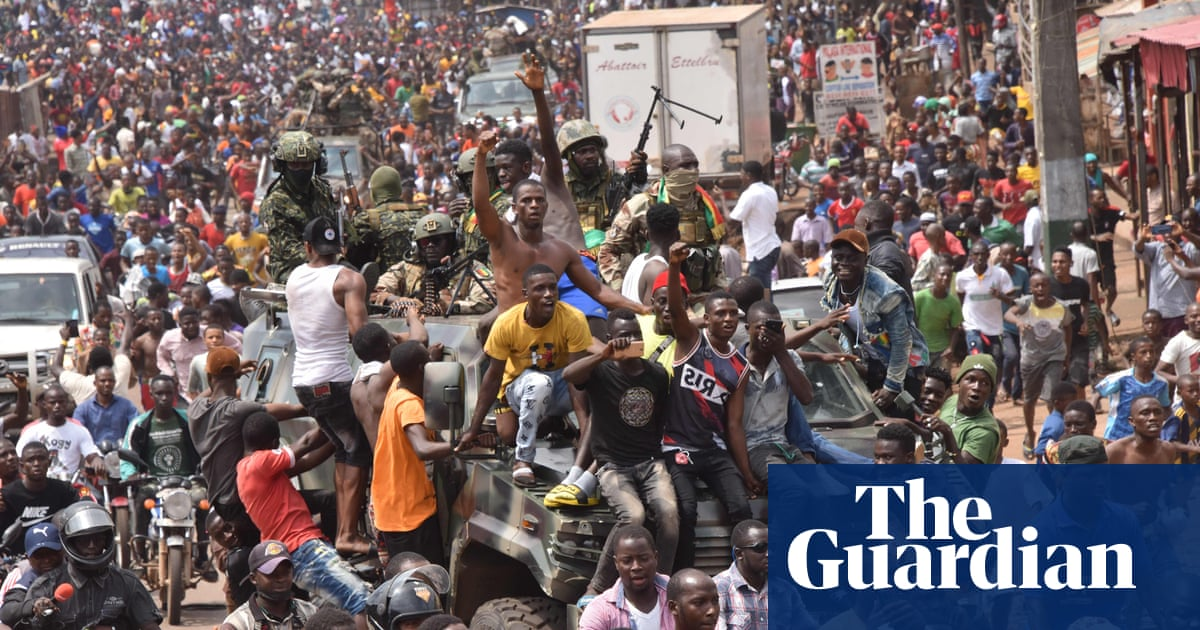 Guinea president held in military detention, say army coup leaders