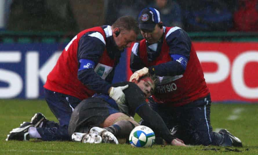 Michael Lipman, being treated during a Heineken Cup match in 2009, was advised by experts to retire but played on for three more years.
