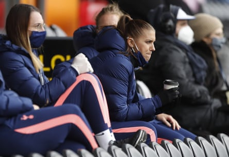 Alex Morgan watches the defeat to Manchester United from the stands.