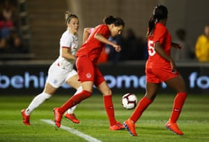 Christine Sinclair slots in from close range.
