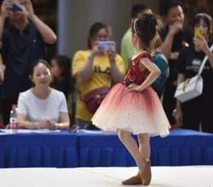 A child poses for the judges