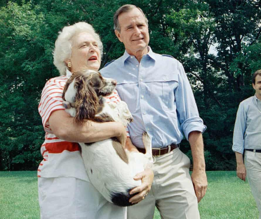 Barbara Bush holding the family dog Millie, 1988; she ghostwrote Millie's memoirs to raise money in support of the Barbara Bush Foundation for Family Literacy.