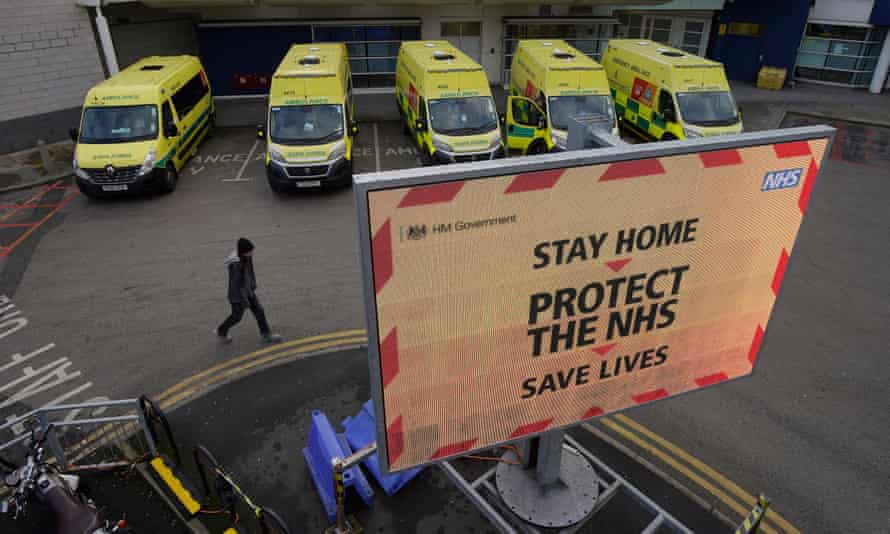 ambulance bay at a hospital and sign saying STAY HOME, PROTECT THE NHS, SAVE LIVES