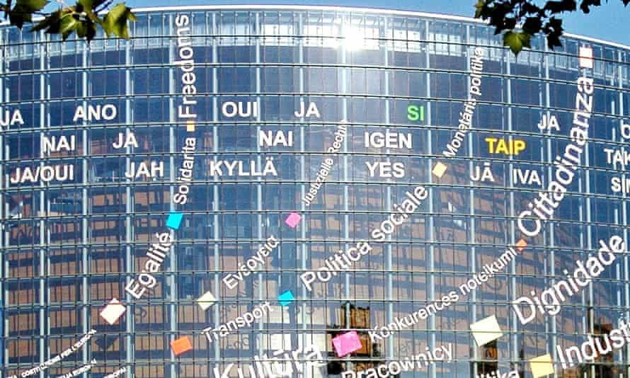 The European parliament building sporting some of the languages spoken by EU member states.