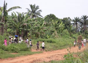 Women and children set off from Kasongo on the 5km walk from fetch water from a stream