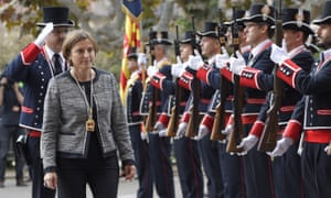 Regional police present arms as Carme Forcadell, new president of Catalonia's parliament, inspects troops