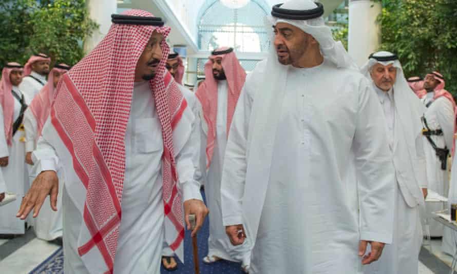 Saudi King Salman, left, talks to Sheikh Mohammed bin Zayed al Nahyan of the UAE.