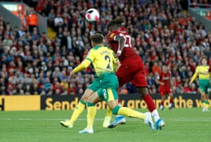 Liverpool's Divock Origi nods in their fourth.