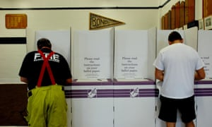 A firefighter votes at Bondi Beach in Sydney, Saturday, Nov. 24, 2007. More than 13.5 million voters are heading to the polling booths in today's Federal Election. (AAP Image/Tracey Nearmy) NO ARCHIVING, INTL OUT