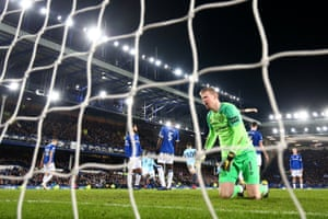 Jordan Pickford of Everton reacts after Aymeric Laporte of Manchester City scores his sides first goal