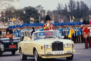 King of Thailand Bhumibol Adulyadej parades in a Rolls-Royce car during a ceremony for his 71th birthday.