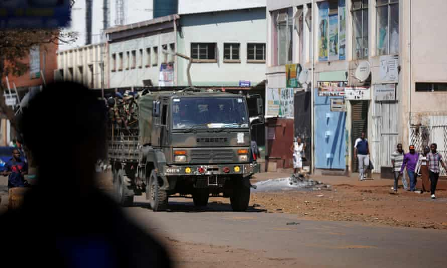 Soldiers patrol the streets of Harare