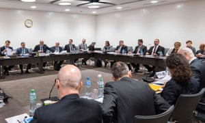 Representatives of the Syrian government and UN officials in talks.