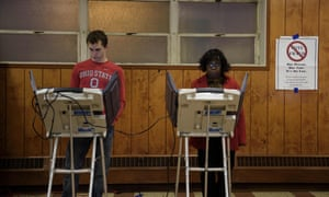 Voters cast ballots in Ohio. A Republican-led House committee has voted to eliminate an election commission.