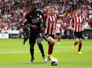 Benteke and O'Connell battle for possession.