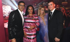 Sindika Dokolo and Isabel dos Santos pose with Paris Hilton and Chris Zylka at a De Grisogono party during the 2018 Cannes film festival