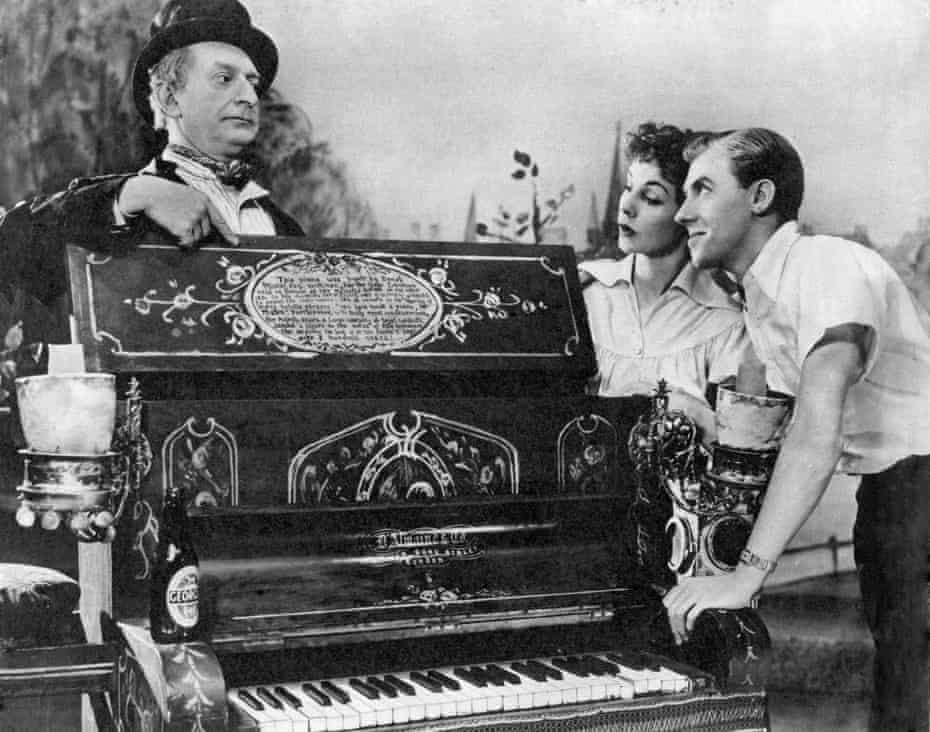 Just the right note … Newton Blick, Eleanor Drew, John Warner and Minnie the magic piano in Salad Days at the Vaudeville, London, in 1954.
