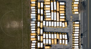 An aerial picture shot by a drone shows an empty athletic field and parked buses at the Caroline G Atkinson school in Freeport, New York