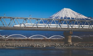 Mount Fuji and one of Japan's distinctive bullet trains.