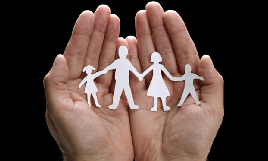 Cut out paperchain family cupped in hands