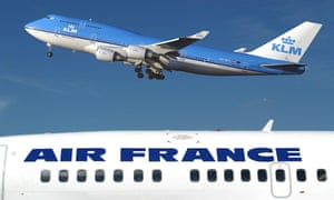 A KLM Boeing 747-400 flies over an Air-France plane.