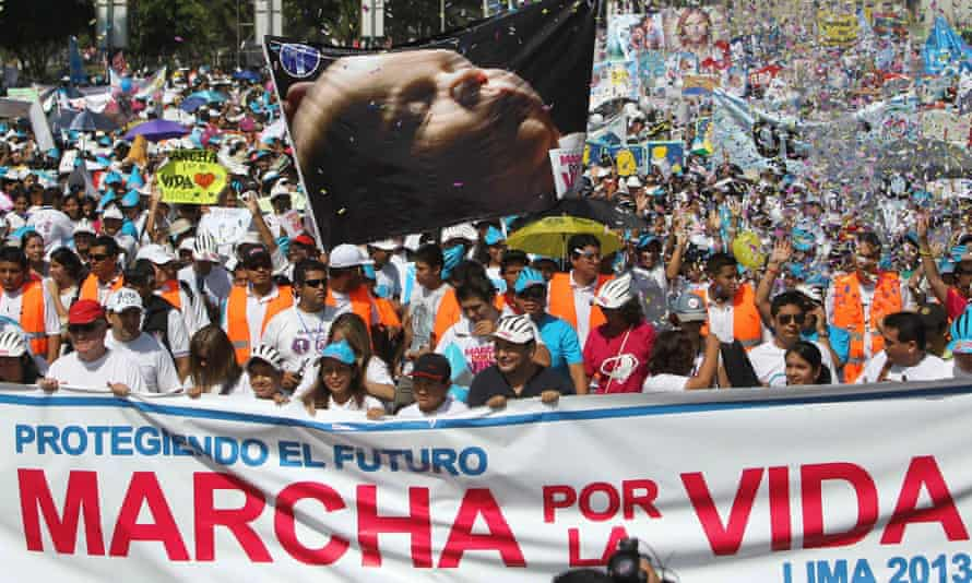 People participate in the 'Great March for Life' to show their rejection of abortion in Lima, Peru on 23 March 2013.