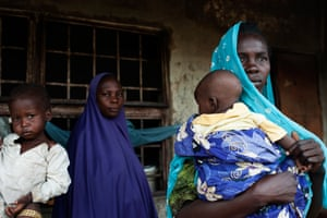 Displaced women and their children in an old squatted house in the Over Sea slam in Maiduguri.